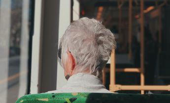 Woman sitting on bus